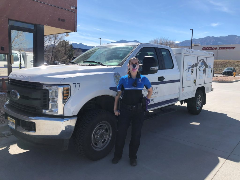 An HSPPR ALE Officer in uniform standing in front of her ALE Truck
